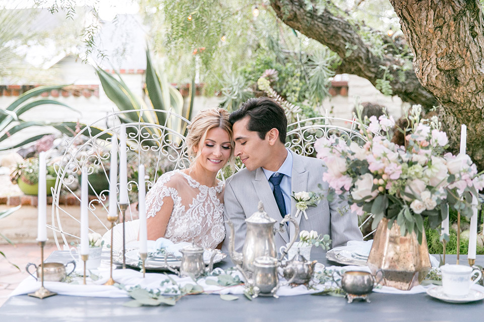 Sherman-library-and-gardens-bride-and-groom-sitting-at-sweetheart-table