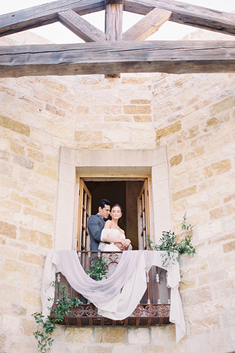Santa-barbara-outdoor-wedding-at-sunstone-winery-bride-and-groom-hugging-in-window