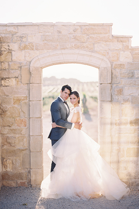 Santa-barbara-outdoor-wedding-at-sunstone-winery-bride-and-groom-hugging-standing-far-away