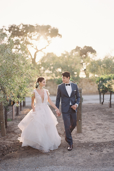 Santa-barbara-outdoor-wedding-at-sunstone-winery-bride-and-groom-walking-holding-hands