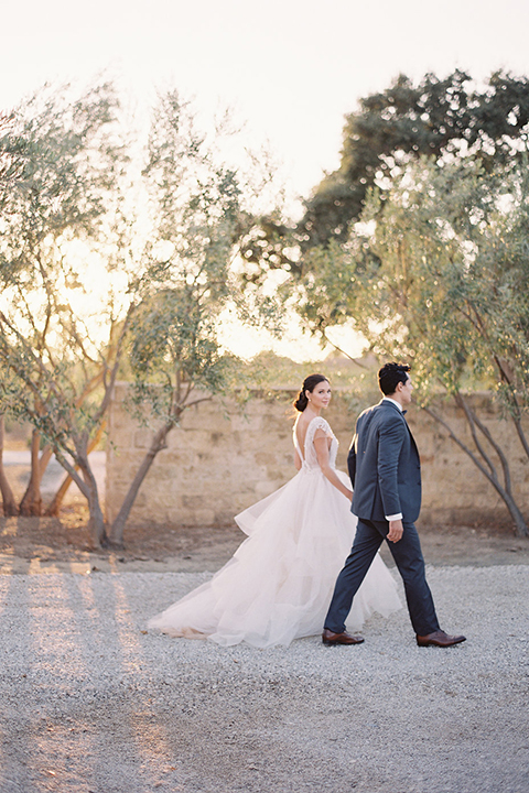 Santa-barbara-outdoor-wedding-at-sunstone-winery-bride-and-groom-walking