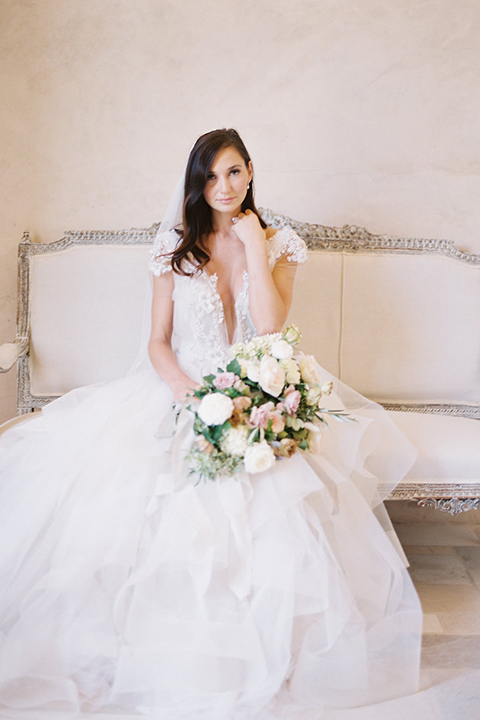 Santa-barbara-outdoor-wedding-at-sunstone-winery-bride-holding-bouquet