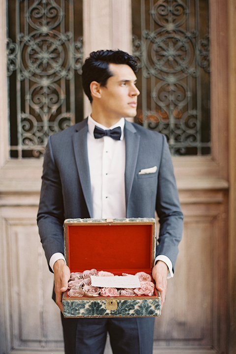 Santa-barbara-outdoor-wedding-at-sunstone-winery-groom-holding-box