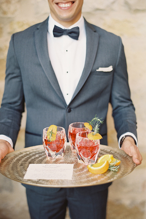 Santa-barbara-outdoor-wedding-at-sunstone-winery-groom-holding-drinks
