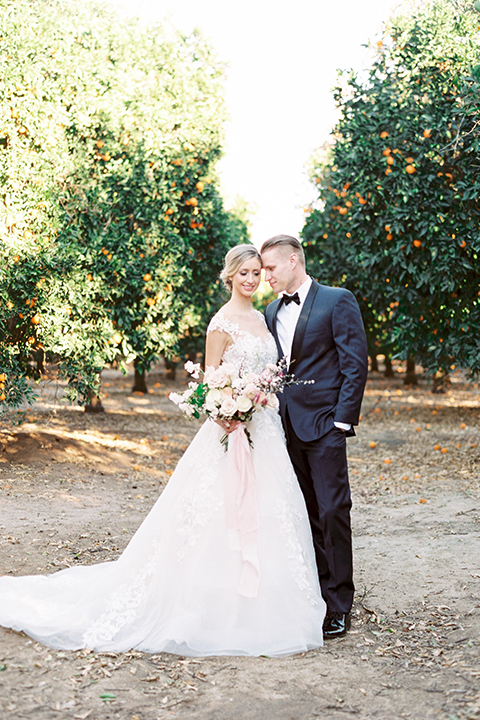 Southern-california-outdoor-wedding-at-the-orange-grove-bride-and-groom-hugging
