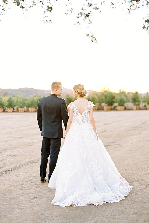 Southern-california-outdoor-wedding-at-the-orange-grove-bride-and-groom-standing-holding-hands