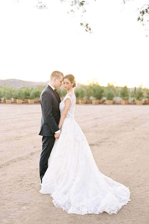Southern-california-outdoor-wedding-at-the-orange-grove-bride-and-groom-standing-hugging-holding-hands