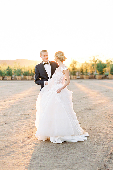 Southern-california-outdoor-wedding-at-the-orange-grove-bride-and-groom-standing-walking-smiling