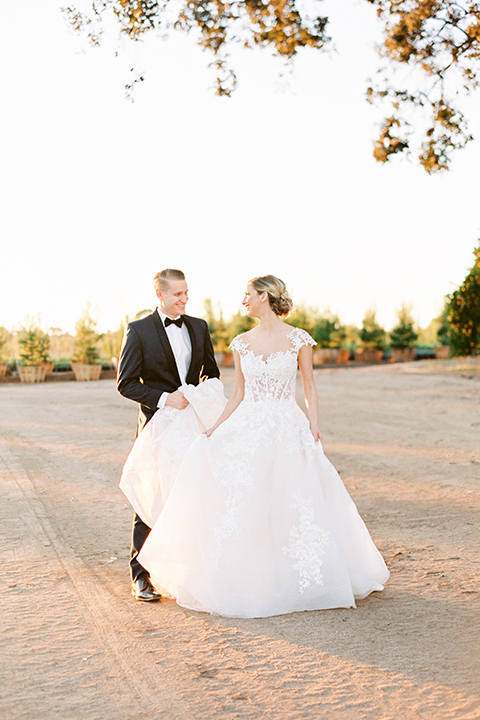 Southern-california-outdoor-wedding-at-the-orange-grove-bride-and-groom-standing-walking