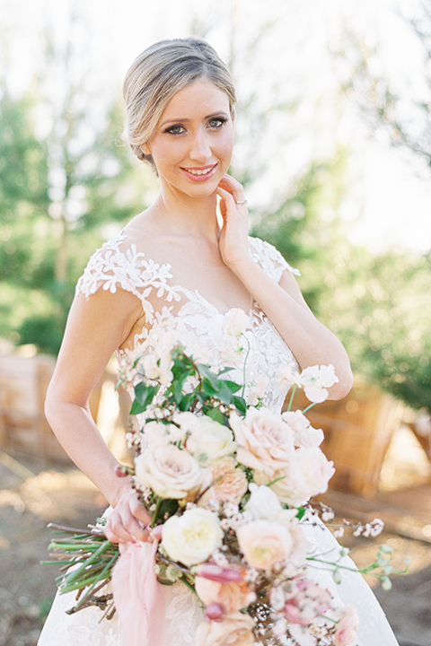 Southern-california-outdoor-wedding-at-the-orange-grove-bride-holding-bouquet-close-up