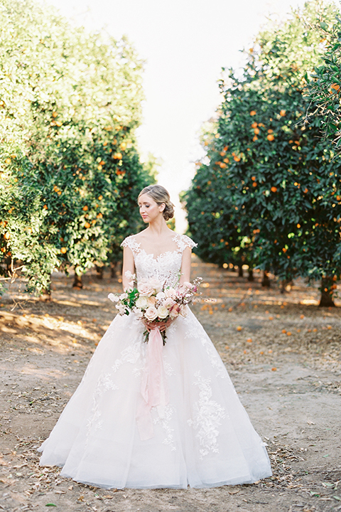 Southern-california-outdoor-wedding-at-the-orange-grove-bride-holding-bouquet
