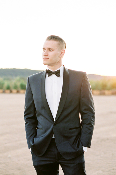 Southern-california-outdoor-wedding-at-the-orange-grove-groom-navy-blue-tuxedo-close-up
