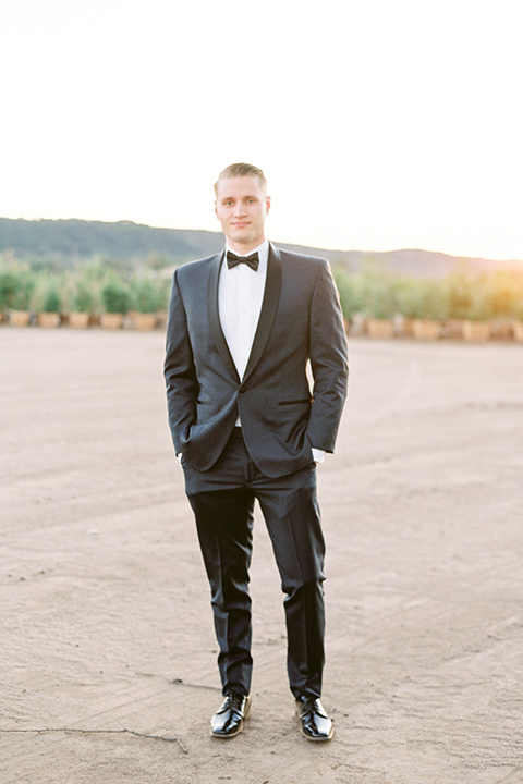Southern-california-outdoor-wedding-at-the-orange-grove-groom-navy-blue-tuxedo