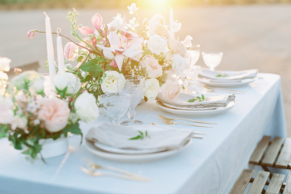 Southern-california-outdoor-wedding-at-the-orange-grove-table-set-up-with-flowers-and-place-settings