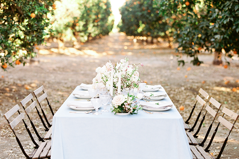 Southern-california-outdoor-wedding-at-the-orange-grove-table-set-up