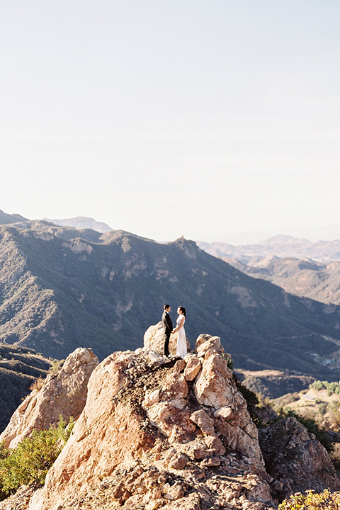 Malibu-rocky-oaks-valentines-day-wedding-shoot-bride-and-groom-holding-hands