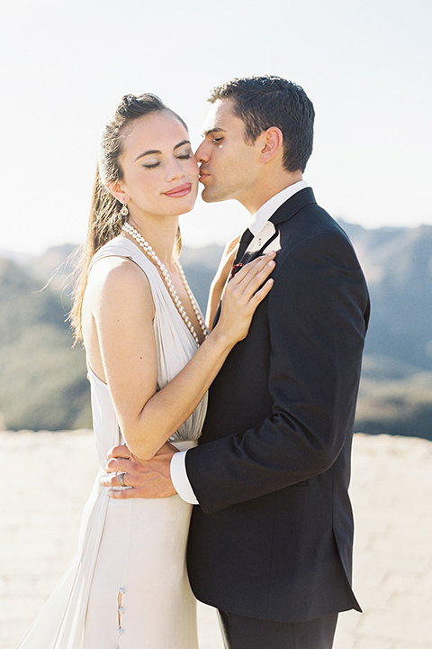 Malibu-rocky-oaks-valentines-day-wedding-shoot-bride-and-groom-hugging-and-kissing