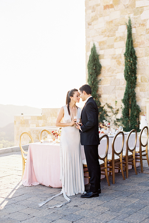 Malibu-rocky-oaks-valentines-day-wedding-shoot-bride-and-groom-standing-by-table