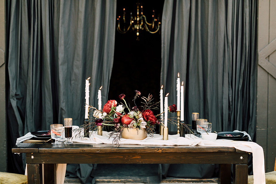 Temecula-wedding-at-wolf-feather-honey-farm-table-set-up-with-flowers-and-candle-decor