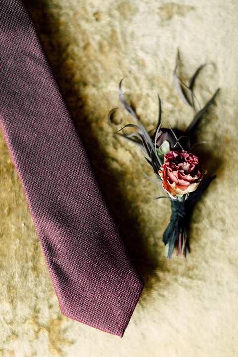Temecula-wedding-at-wolf-feather-honey-farm-wedding-groom-tie-with-red-floral-boutonniere