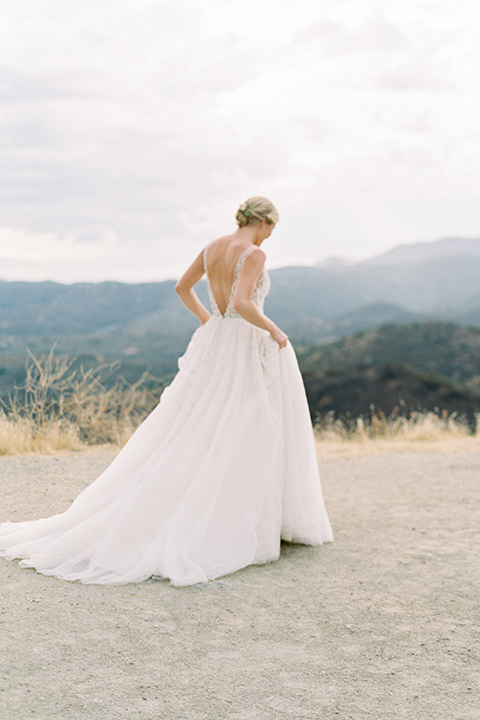 mountain-elopement-shoot-bride-walking-bride-at-camera-Bride-in-a-tulle-ball-gown-with-an-illusion-bodice-and-lace-detailing