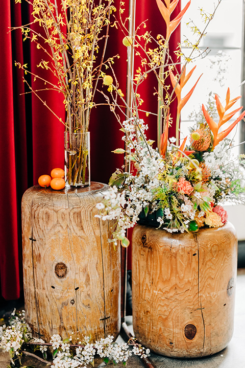 Ace-Hotel-Wedding-ceremony-décor-with-hanging-flowers-in-orange-and-pink-tones