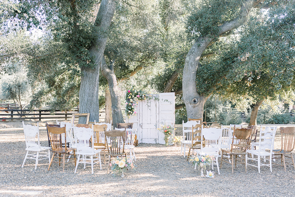 alice-in-wonderland-shoot-ceremony-set-up-with-different-style-of-chairs-in-white-and-natural-wood