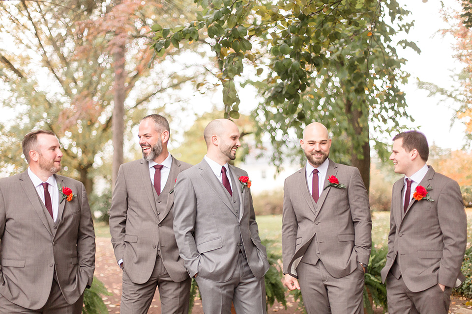 groom and groomsmen in brown suits with red ties and brown shoes