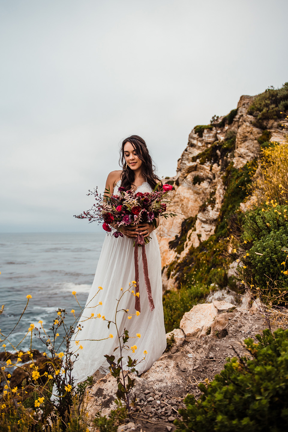 avila-beach-elopement-shoot-bride-in-a-soft-flowing-gown-with-a-strapless-neckline-and-a-big-bouquet-of-flowers