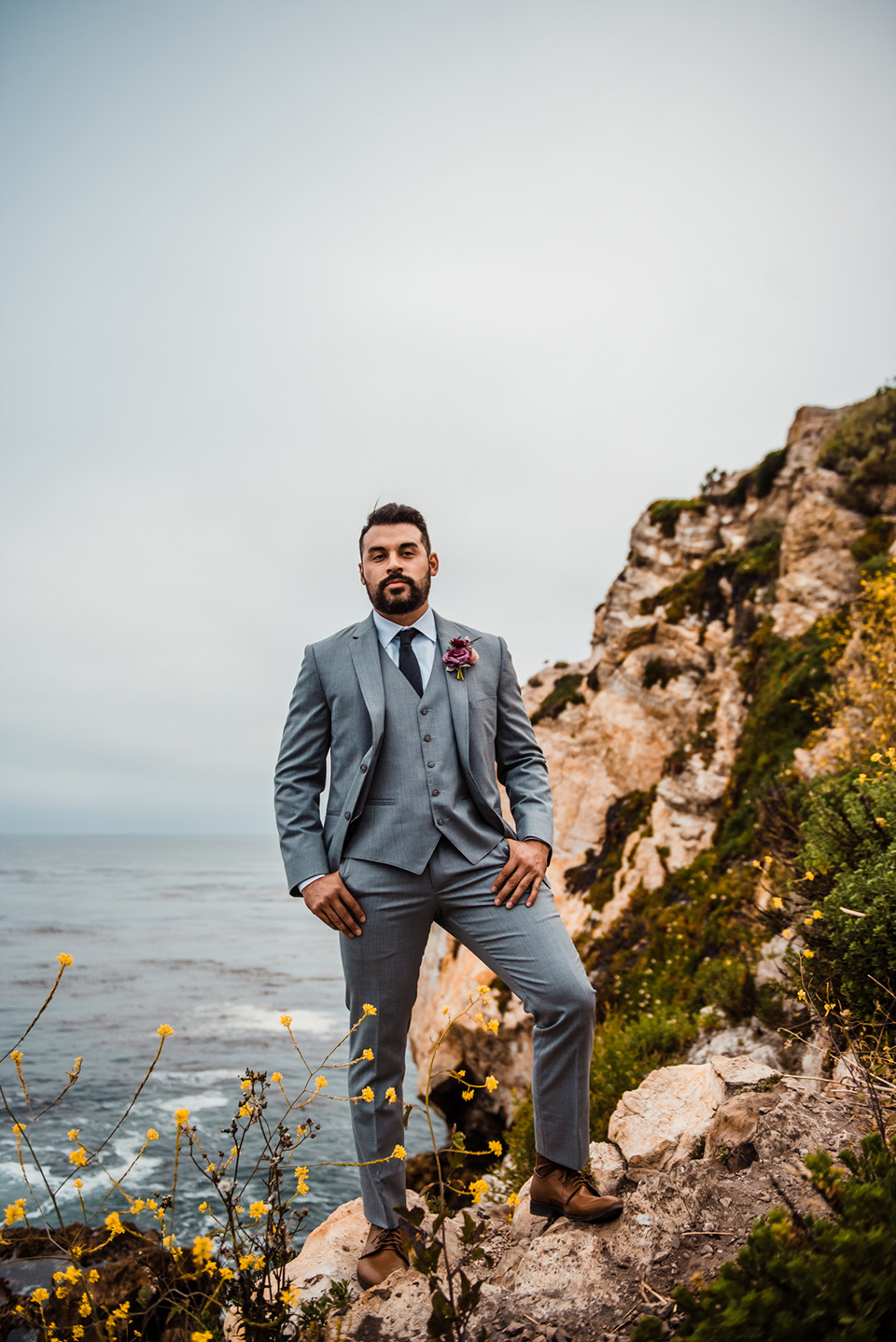 avila-beach-elopement-shoot-groom-wearing-a-light-blue-suit-with-a-navy-long-tie