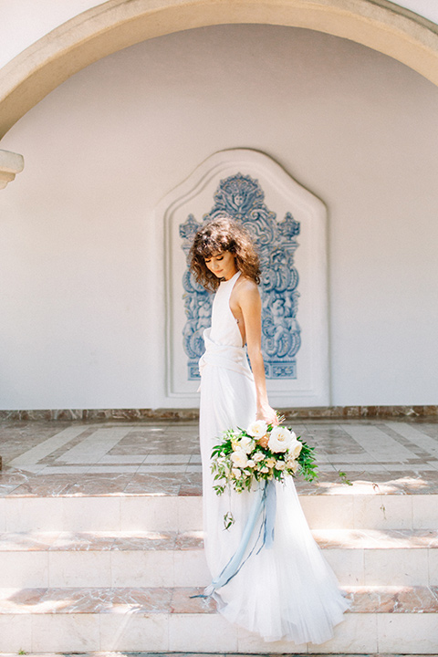 Rancho-las-lomas-blue-shoot-bride-in-gown-in-a-flowing-white-gown-and-a-halter-neckline