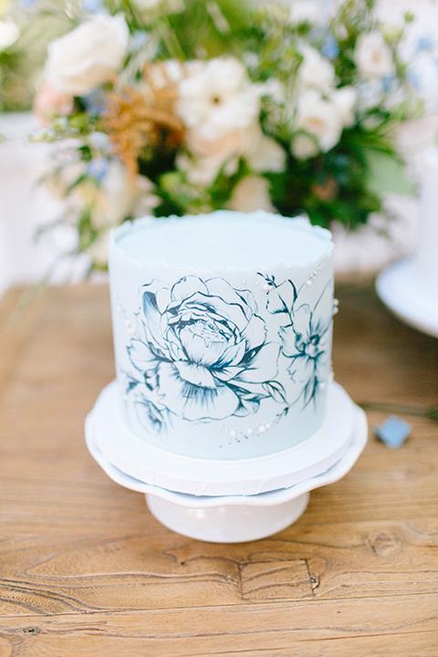 Rancho-las-lomas-blue-shoot-whtie-cake-with-blue-lace-style-decor