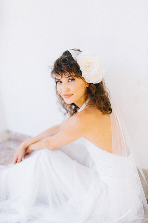 Rancho-las-lomas-blue-shoot-close-up-on-bridal-in-a-white-dress-with-a-halter-neckline