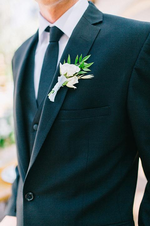 Rancho-las-lomas-blue-shoot-groom-attire-close-up-in-a-black-suit-with-a-black-long-tie