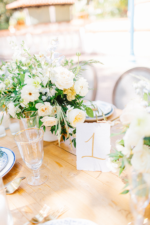 Rancho-las-lomas-blue-shoot-table-décor-with-white-linens-and-gold-decor