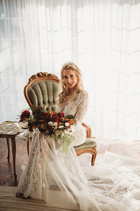 owl-creek-farms-bride-sitting-down-bride-wearing-a-boho-style-dress-with-long-sleeves-and-a-high-neckline