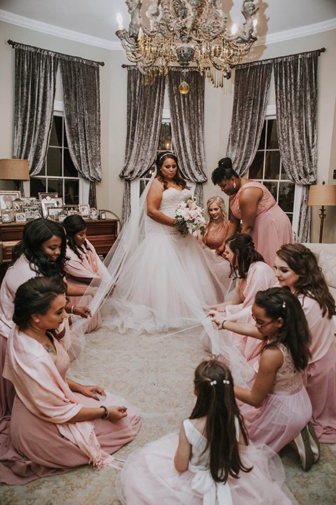 Fete-Venue-New-Orleans-Wedding-bridesmaids-in-pink-dresses-bride-in-a-strapless-ball-gown