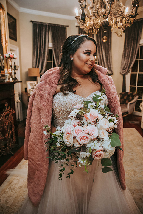 Fete-Venue-New-Orleans-Wedding-bride-with-fur-jacket-bride-in-a-strapless-ball-gown-with-a-pink-fur-shawl