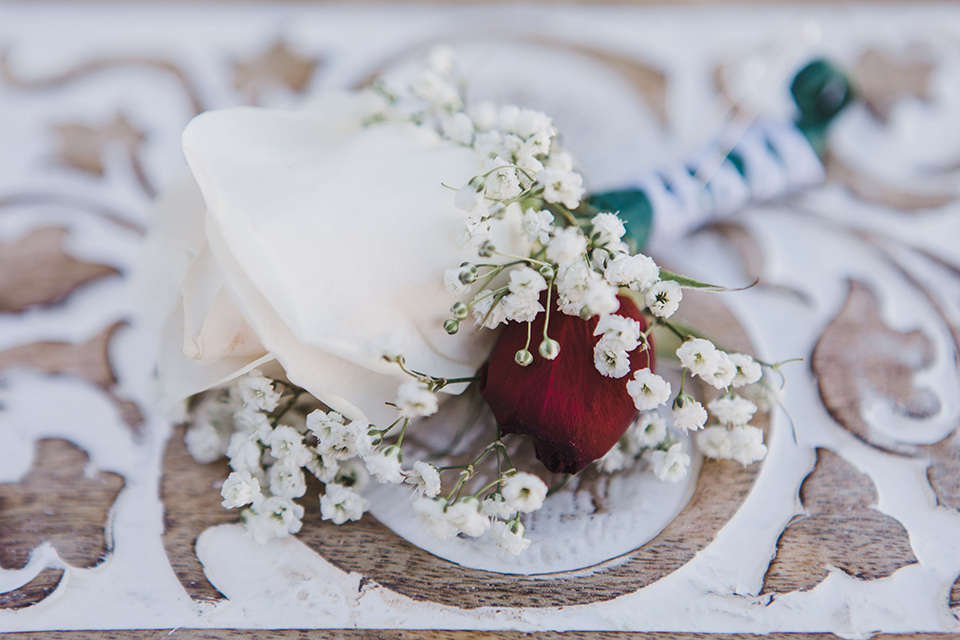 chateau-raquel-romantic-wedding-boutionnere-with-white-roses-and-red-accents