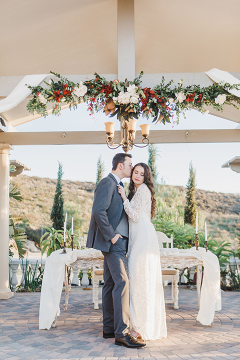 cchateau-raquel-romantic-wedding-bride-and-groom-in-gazeebo-bride-in-a-romantic-white-gown-groom-in-a-dark-grey-suit