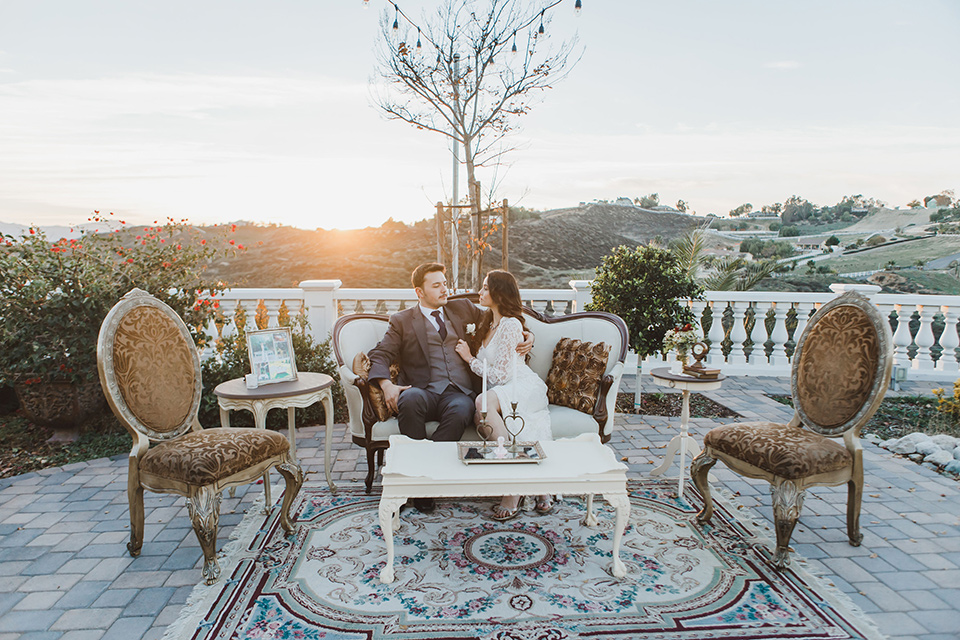 chateau-raquel-romantic-wedding-bride-and-groom-on-couch