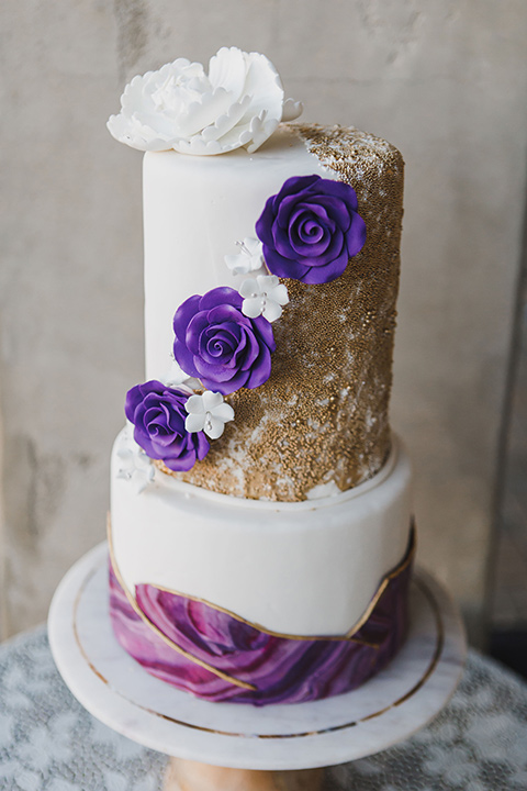chateau-raquel-romantic-wedding-cake-with-white-fondant-and-purple-and-gold-accents