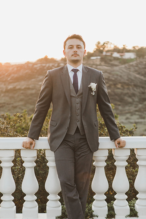 chateau-raquel-romantic-wedding-groom-model-standing-waering-a-grey-suit-with-a-light-grey-vest
