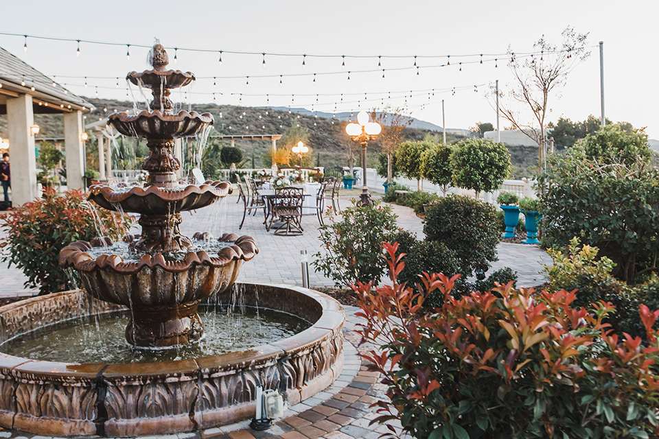 chateau-raquel-romantic-wedding-outdoor-space-with-a-fountain-and-gardens