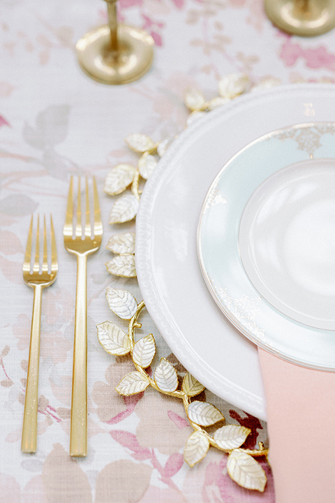 pink floral table linen with gold charger plates and flatware