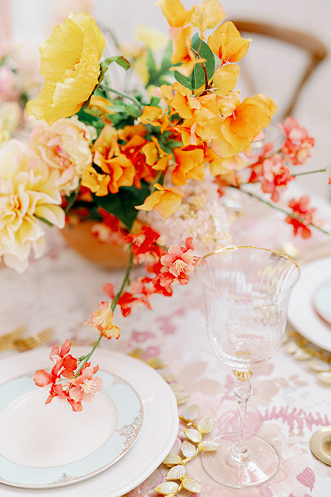 pink and white floral linen with gold and white flatware and decor