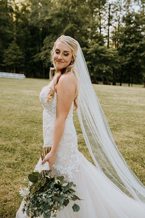Horse-Range-Vista-bride-standing-in-a-lace-strapless-mermaid-gown