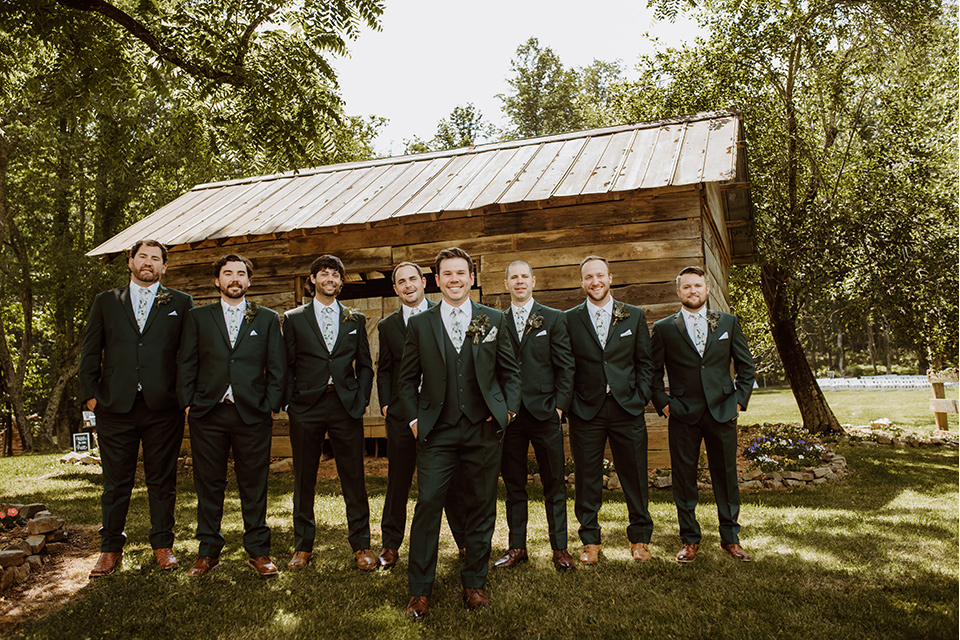 Horse-Range-Vista-groomsmen-and-groom-in-a-green-suits-with-a-floral-ties