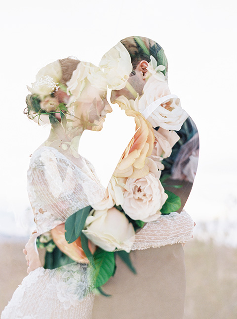 Desert-Lux-Shoot-bride-and-groom-with-floral-design-effect-the-bride-is-in-a-long-lace-gown-with-long-sleeves-and-a-high-neckline-the-groom-is-in-a-black-tuxedo-and-black-bow-tie
