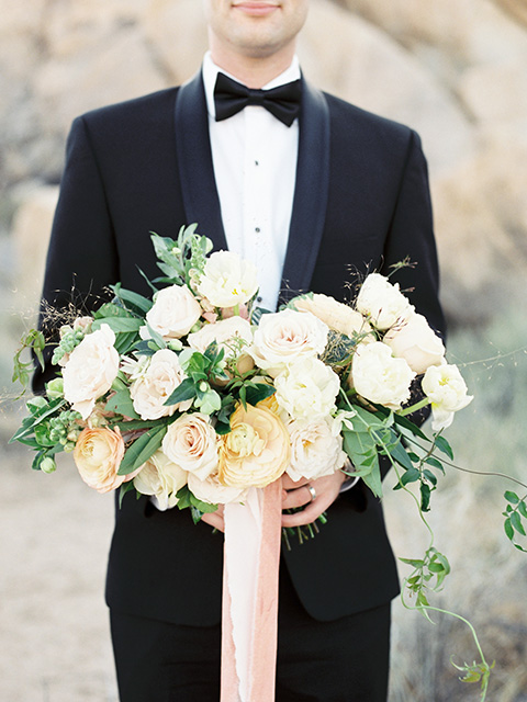 Desert-Lux-Shoot-close-up-on-groom-in-a-black-tuxedo-and-black-bow-tie